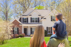 Mixed Race Young Family Looking At Beautiful New Home and learning how to Buy a House While in Debt