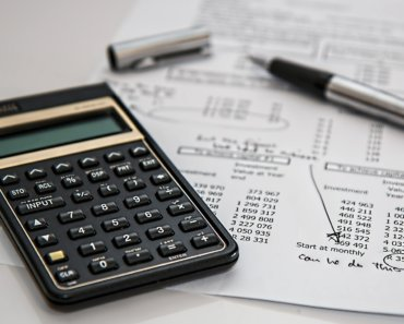 a calculator on a desk running financial numbers - How can Equity help a Household