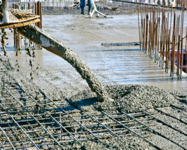 Concrete pouring during commercial concreting floors of buildings at construction site - Tracking Recent Changes in the Concrete Industry According to Paul Garibotti of Northfleet Concrete Floors Inc.