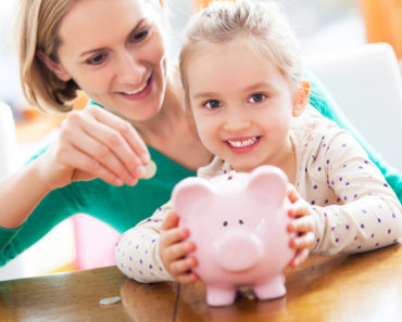 image of mother and daughter saving money in a piggy bank - How to Save for your Next Vacation without Compromising your Quality of Life.